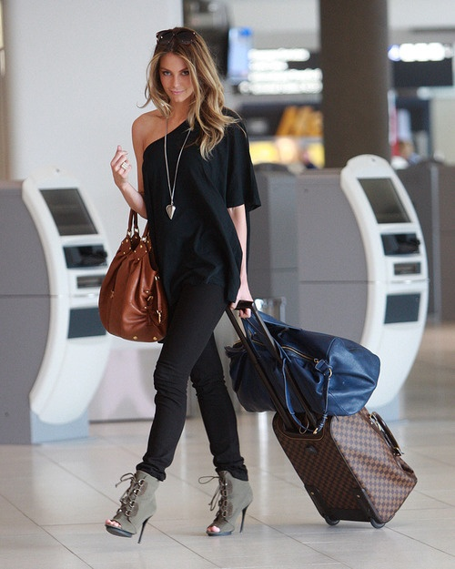 Not me but she seems happy to have her YSL bag!